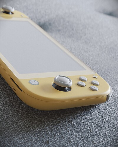 NintendoSwitchLite_OnCouch_Detailshot2